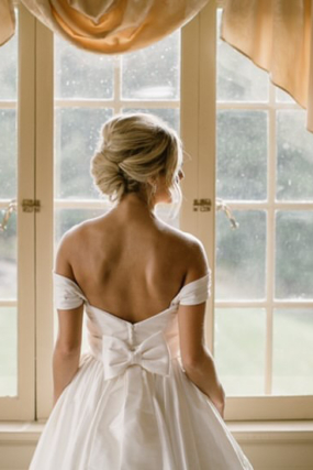 bride with bow on back of wedding dress hannah cooper photography