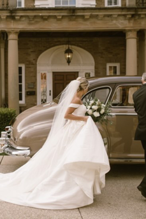 bride with vintage car Hannah Cooper photography