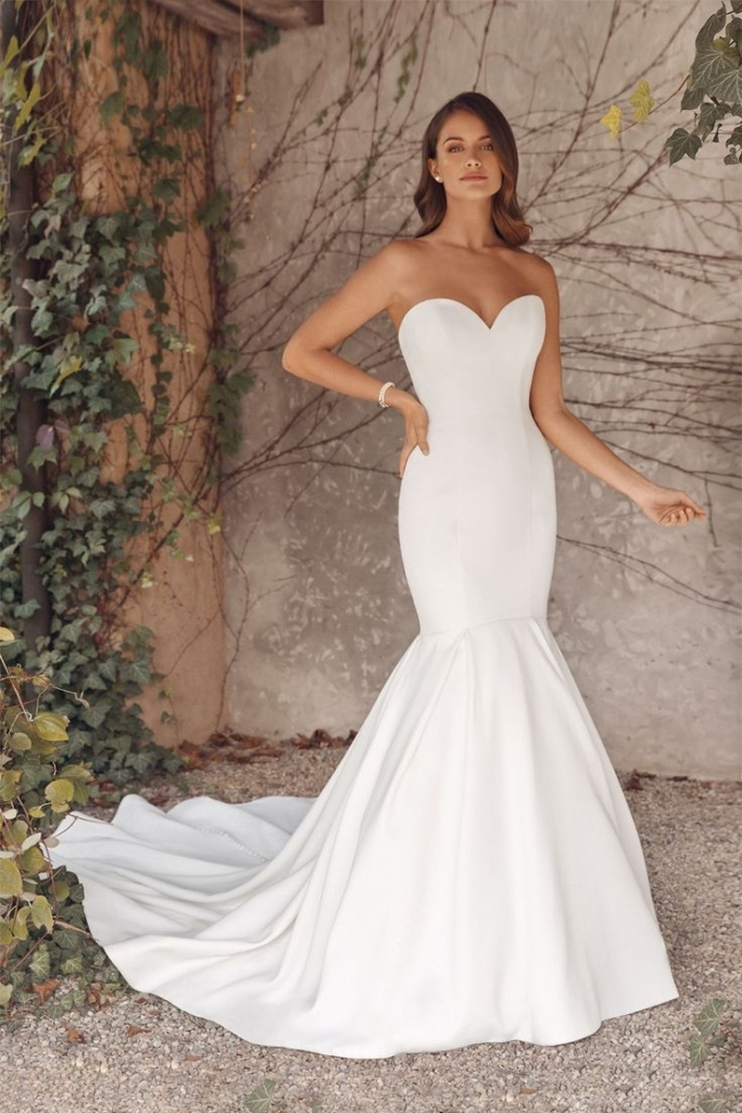 Simple elegant fit and flare wedding dress by Justin Alexander