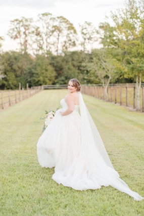 bride running at farm Christa Rene Photography