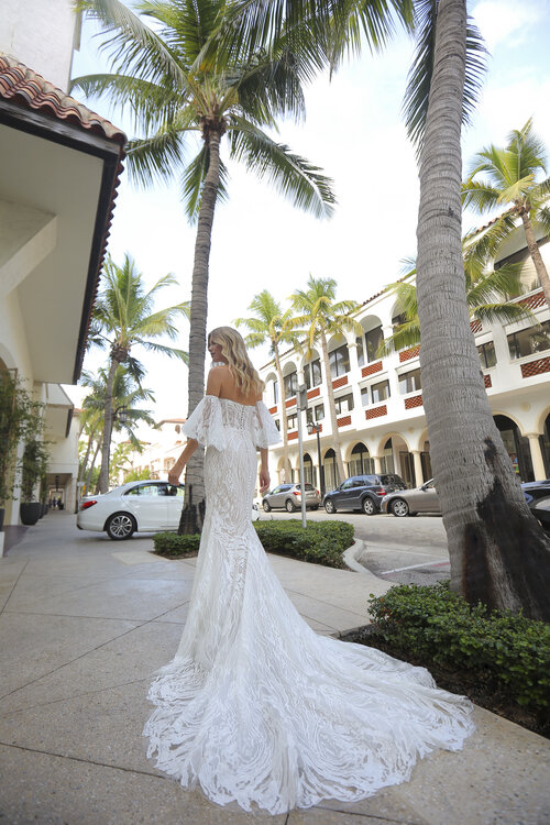 Boho wedding dress with off the shoulder neckline and ruffled sleeve