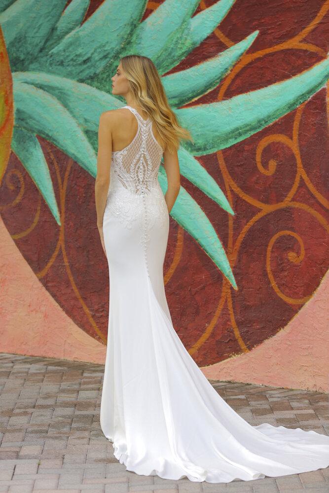 Crepe wedding dress with dramatic razor back by Randy Fenoli in Tampa